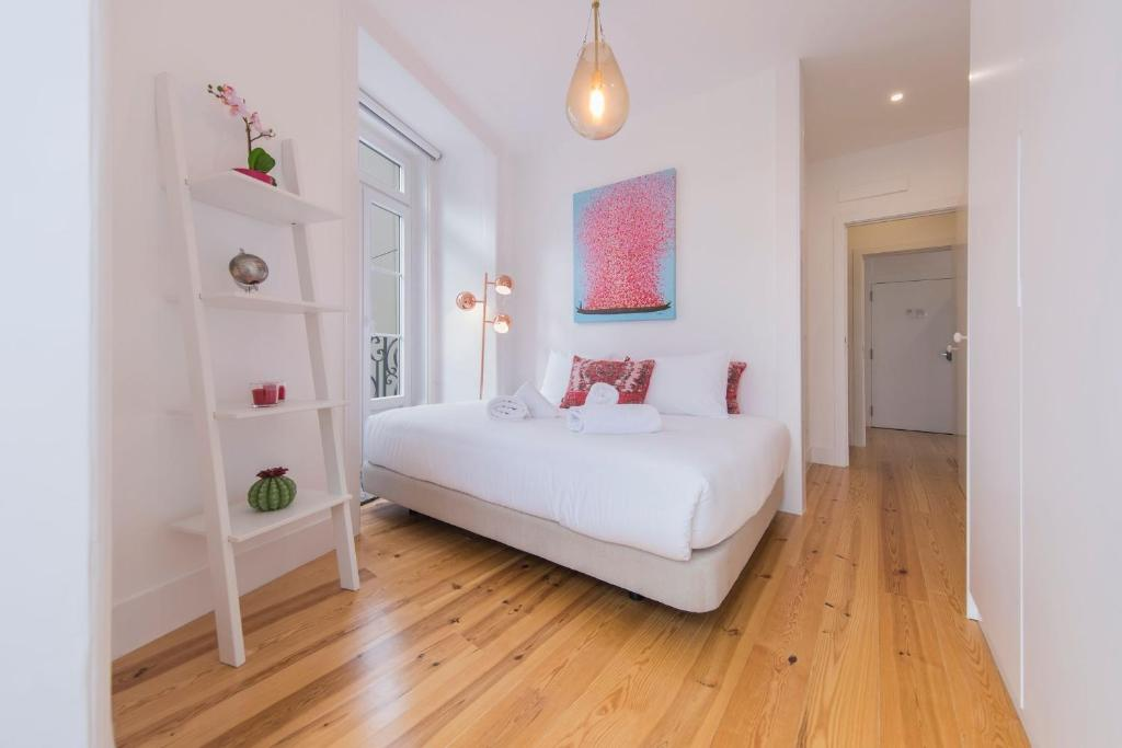 A bed or beds in a room at LovelyStay - Lusitano's Heart 2BDR Apartment in Alfama