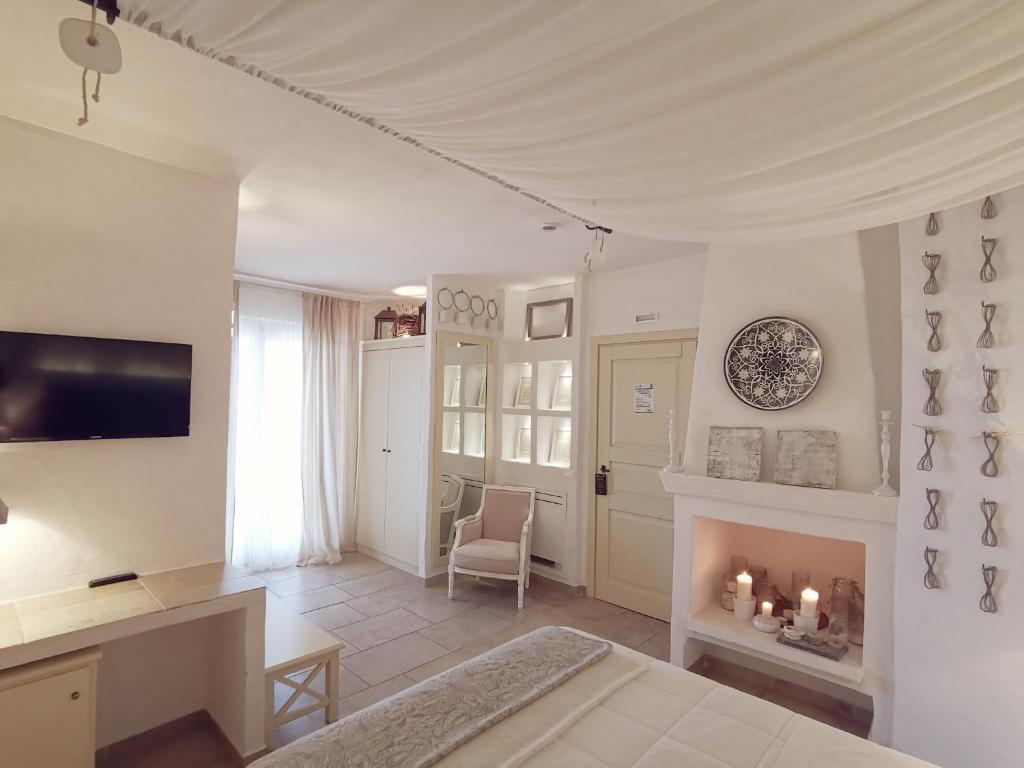 TV o dispositivi per l'intrattenimento presso Le Nicchie Guest House