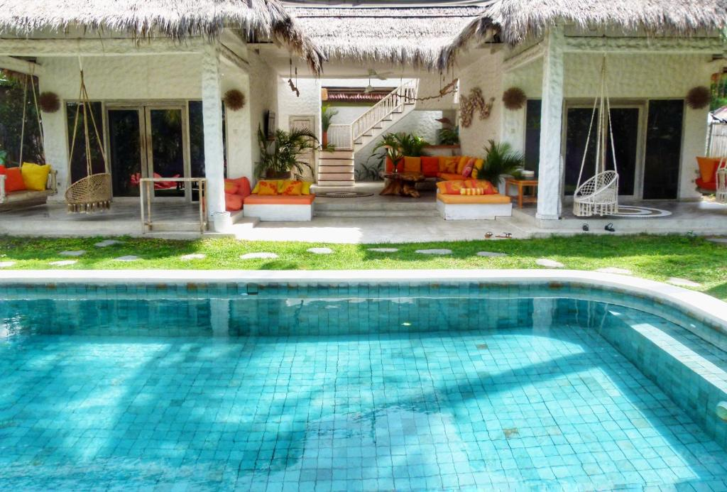The swimming pool at or near Villa Rustic Charm