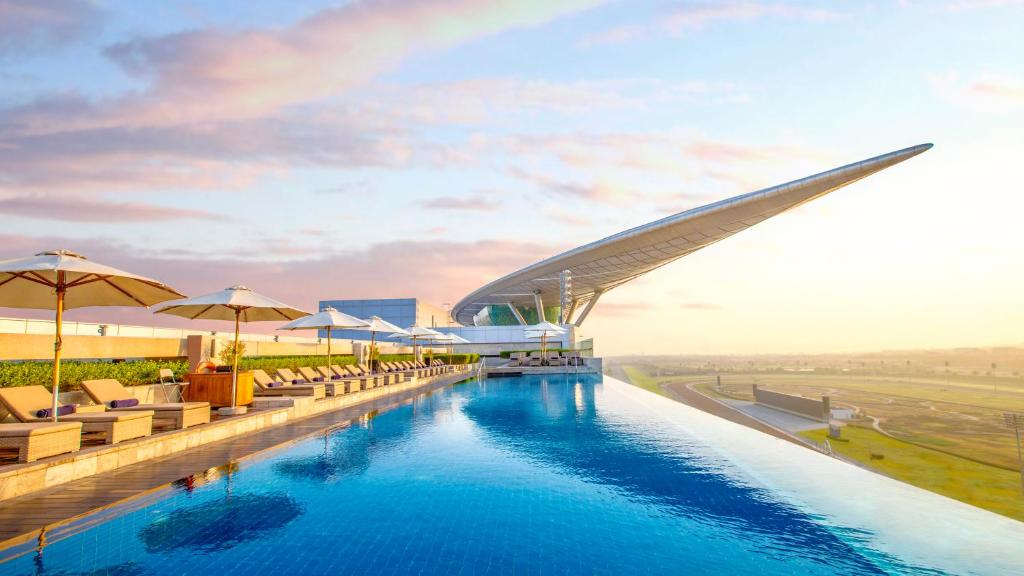 The swimming pool at or near The Meydan Hotel