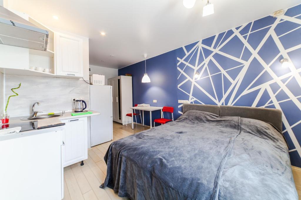 A bed or beds in a room at 3-я Студия Боровское шоссе