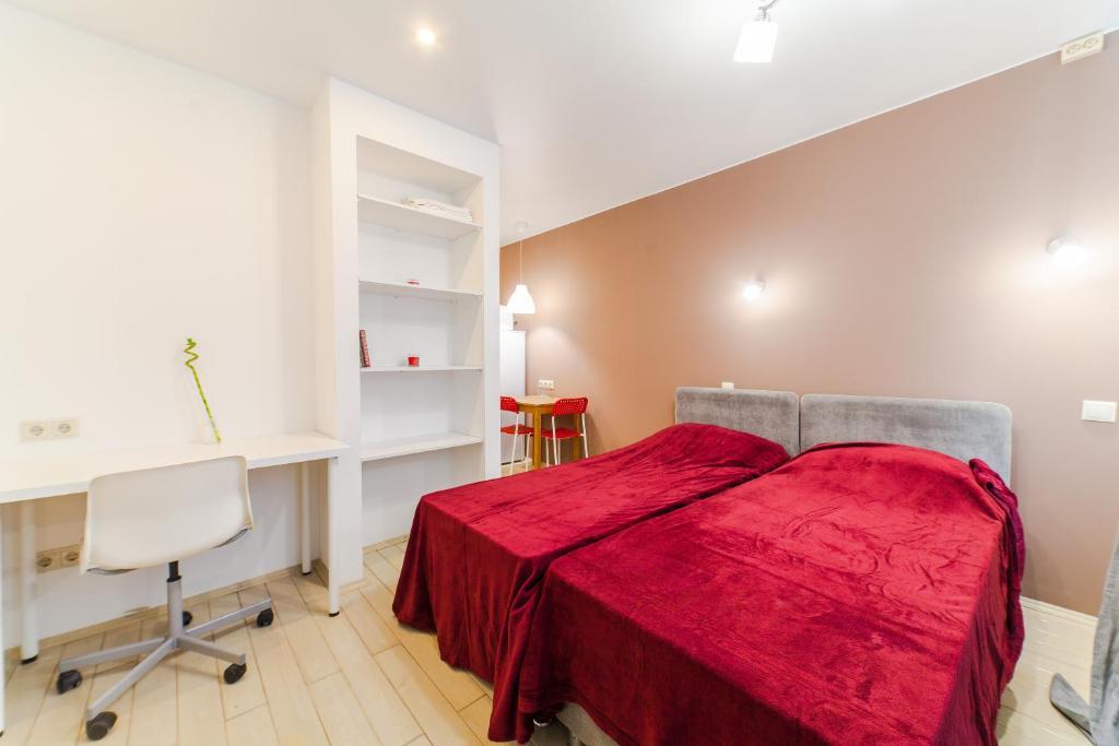A bed or beds in a room at 4-я Студия Боровское шоссе