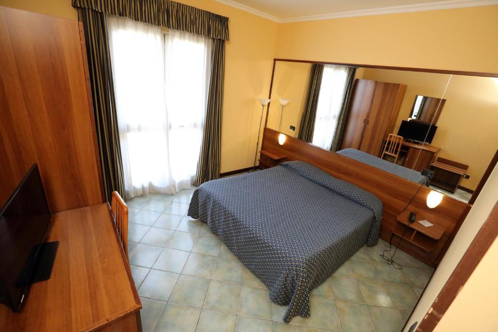 Letto o letti in una camera di Hotel Palacavicchi