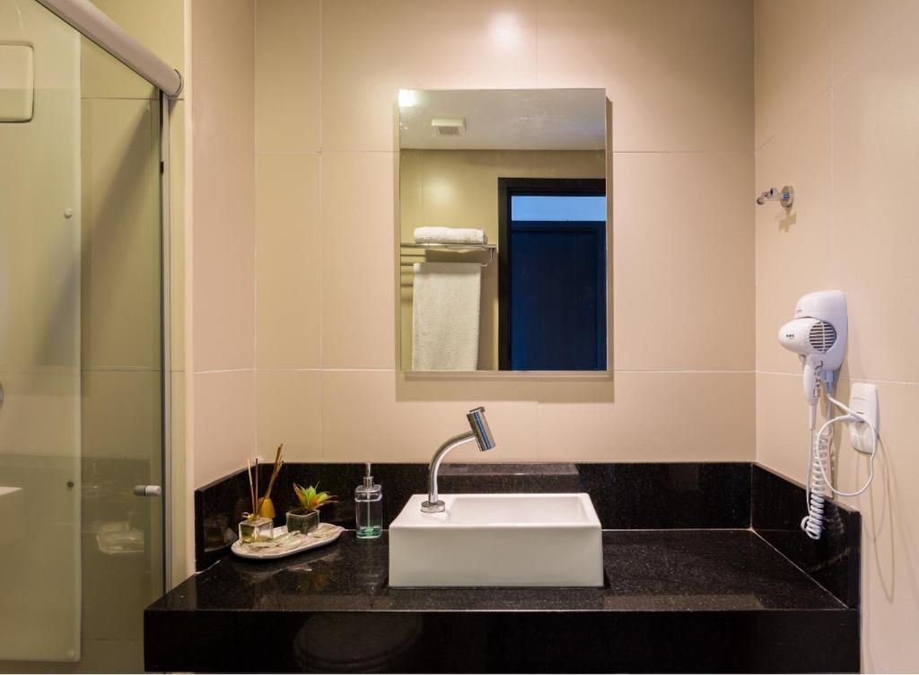 A bathroom at Apart Hotel em Boa Viagem