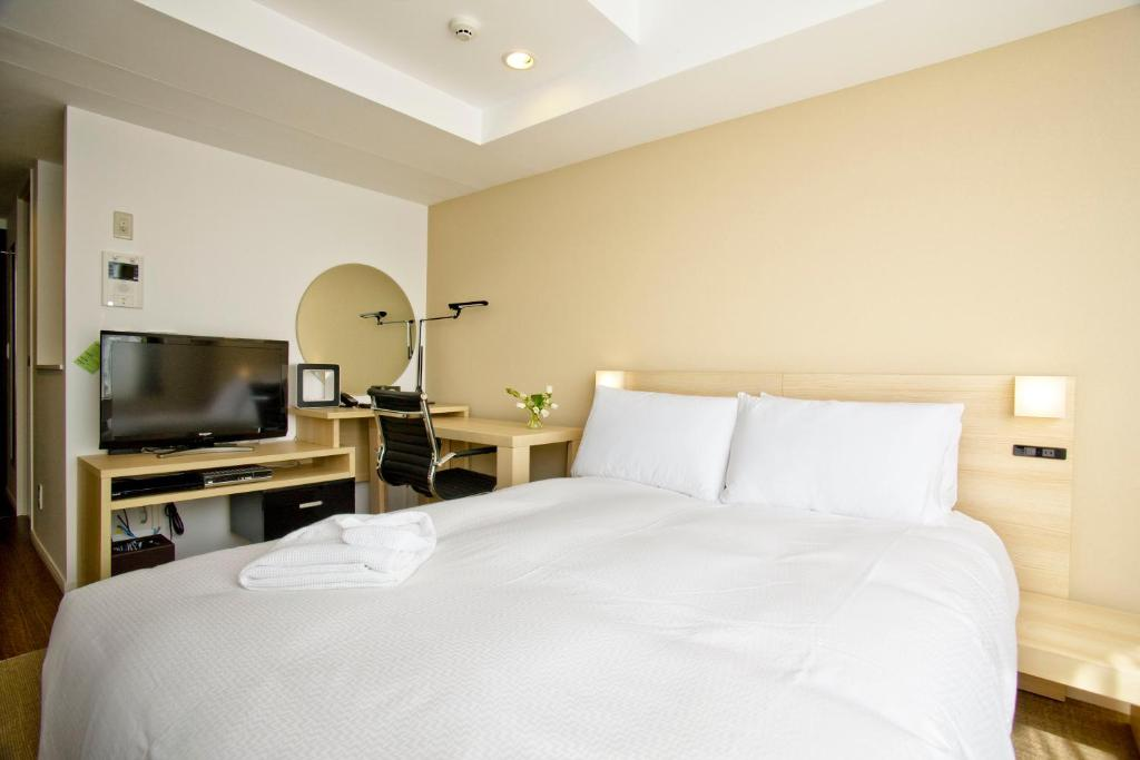A bed or beds in a room at B:CONTE Asakusa