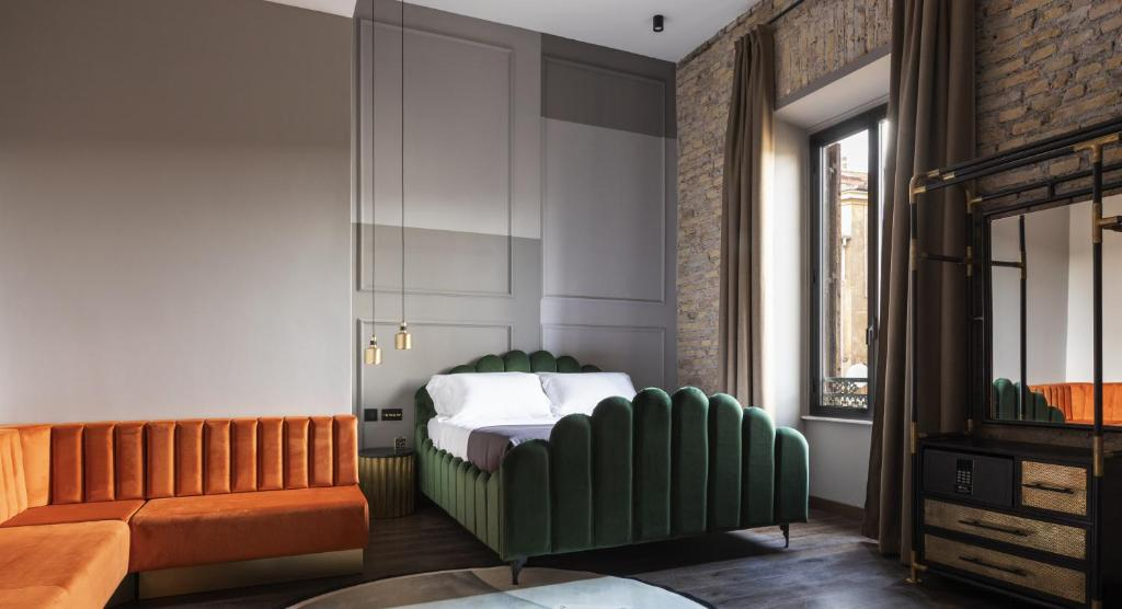 A bed or beds in a room at Chapter Roma