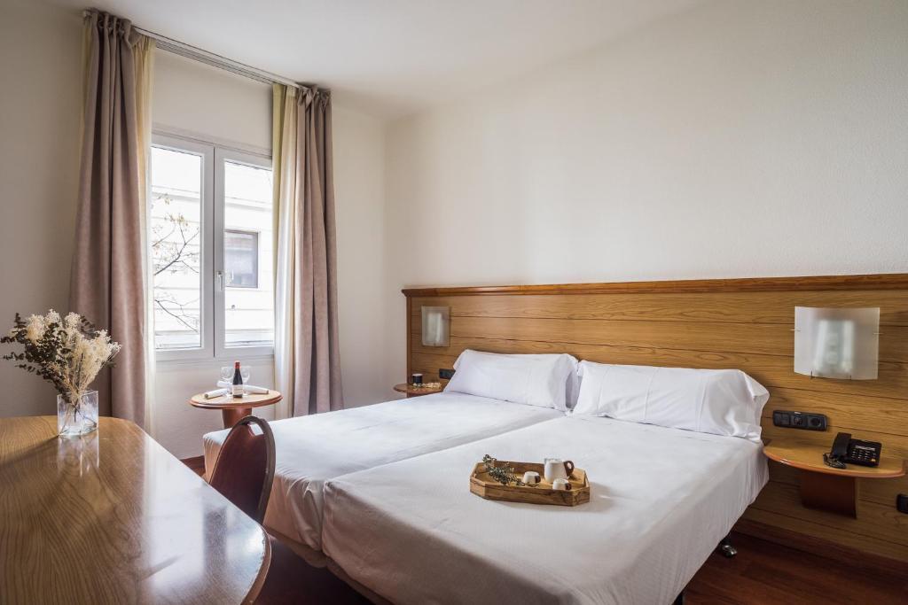 Cama o camas de una habitación en Negresco Gran Via