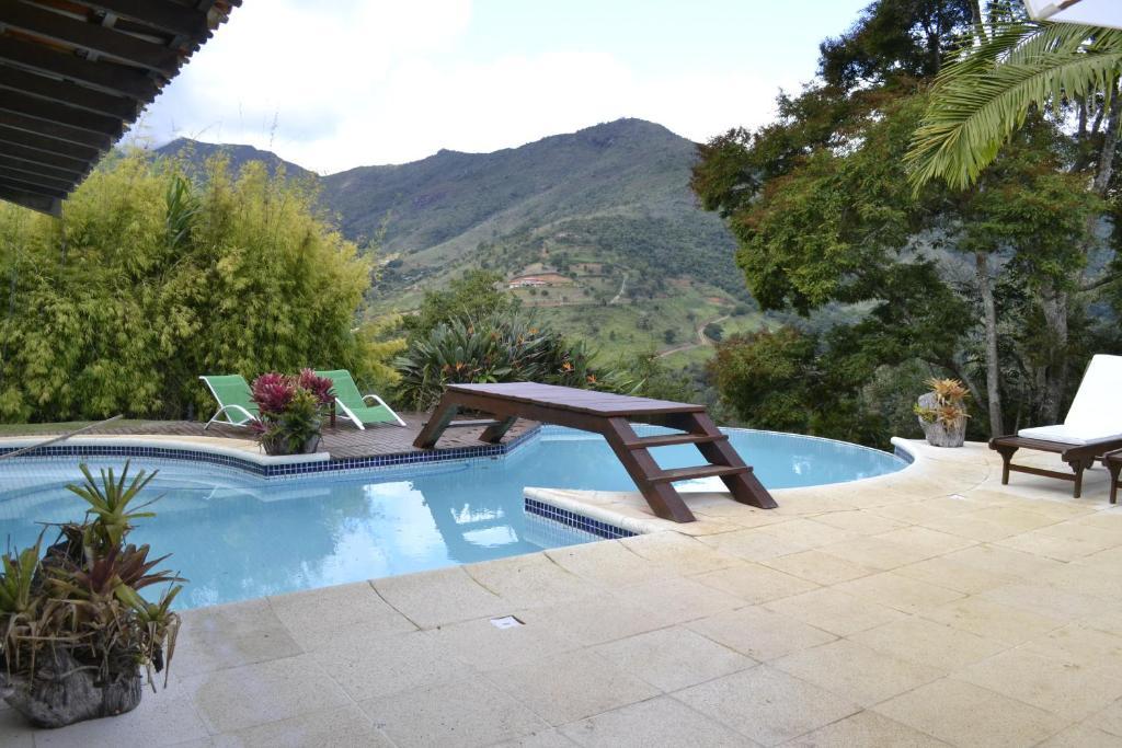 The swimming pool at or close to Pousada Rancho da Ferradura
