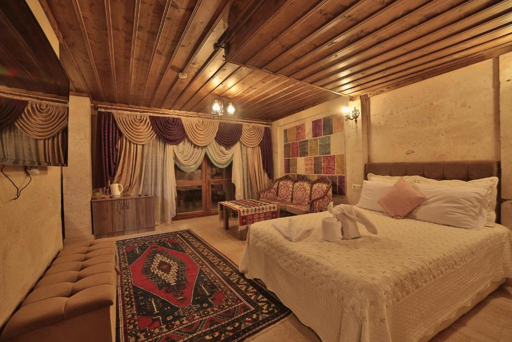 A bed or beds in a room at Goreme Cave Rooms