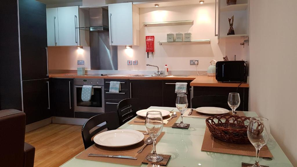 A kitchen or kitchenette at Abbots Yard Apartments with Lily Pad Living