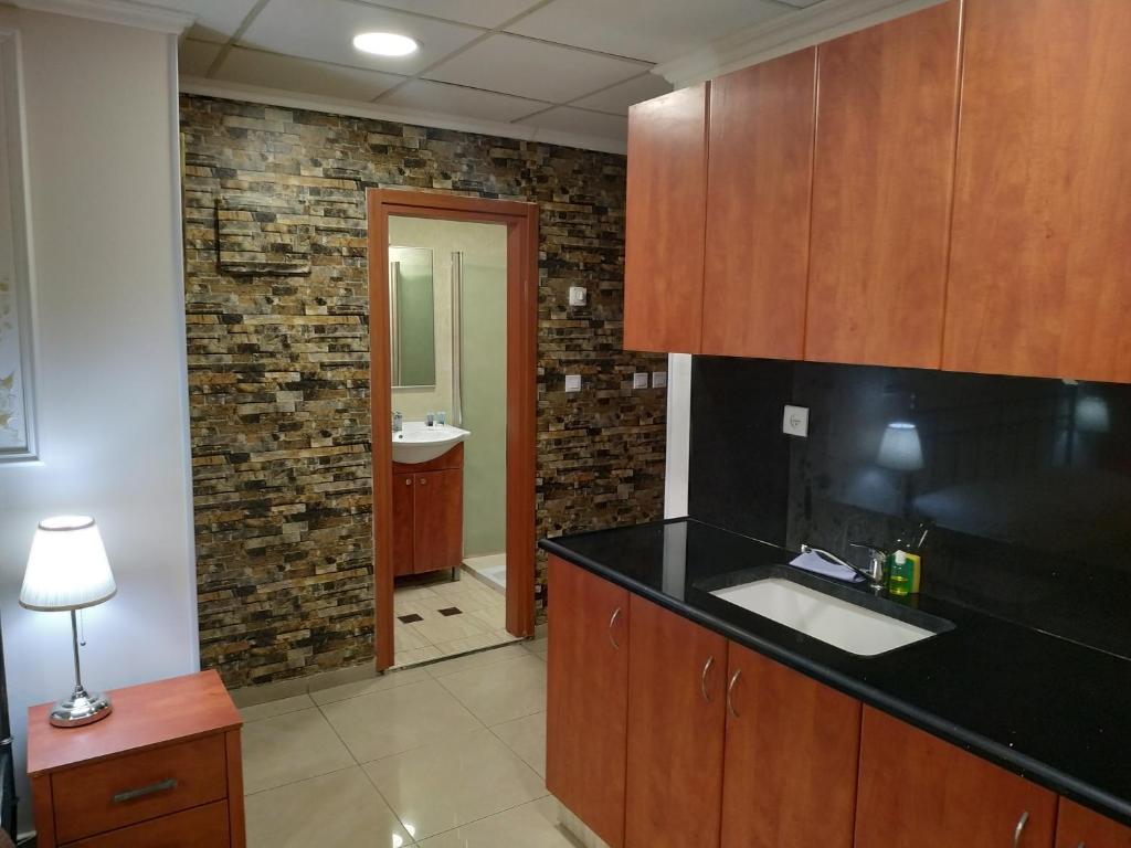 "A kitchen or kitchenette at ApartHotel ""Ha-Tzomet"""