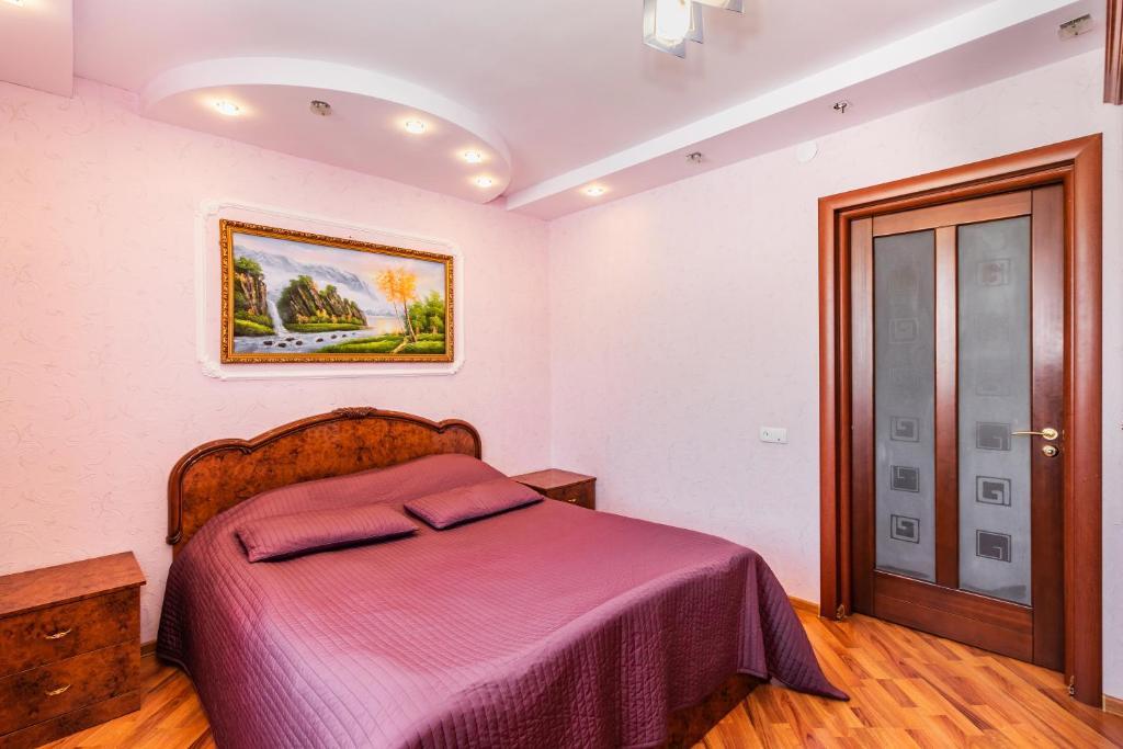 Кровать или кровати в номере Apartment House