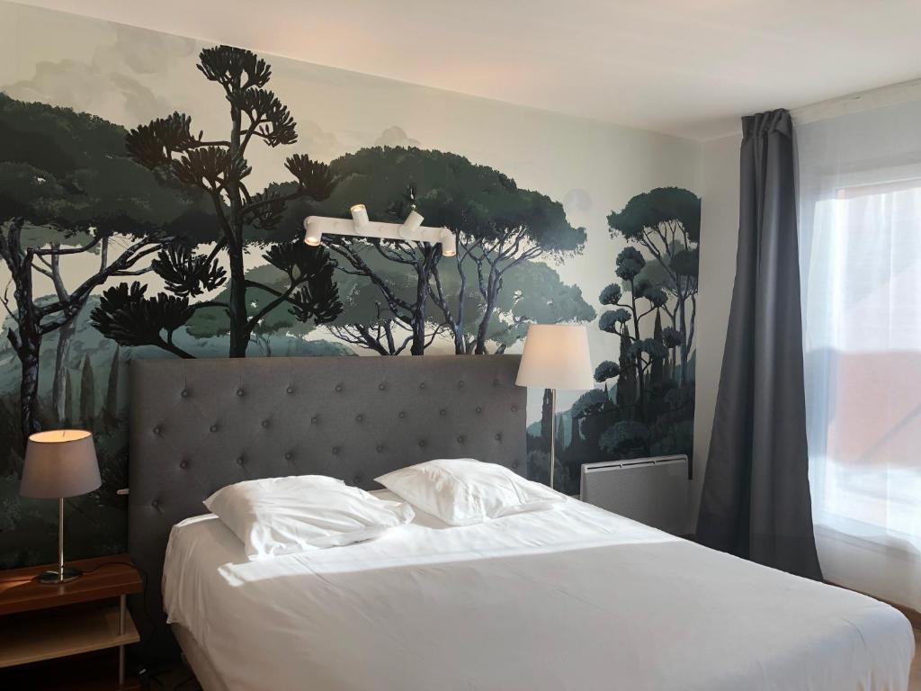 A bed or beds in a room at Villa Val Senart 1ere Avenue