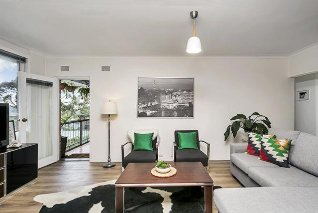A seating area at Leafy Apartment in Lane Cove - JANET
