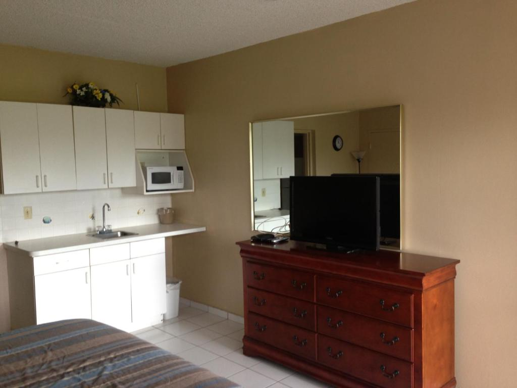 A television and/or entertainment center at Knights Inn Hallandale