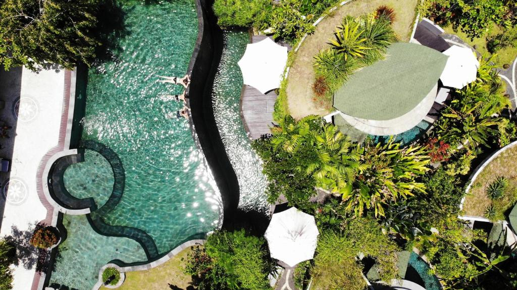 A view of the pool at De Moksha Eco Friendly Boutique Resort or nearby