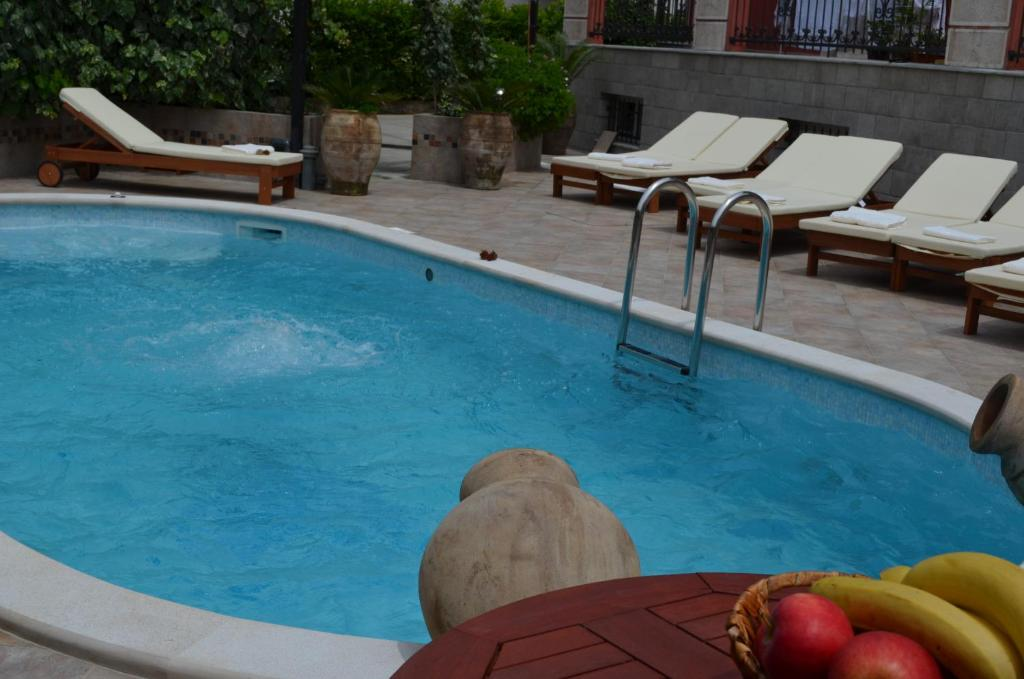 The swimming pool at or near Apartments Bogdanovic
