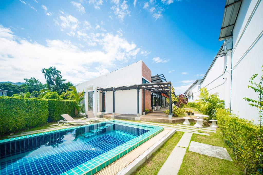 The swimming pool at or near ChillHub Hostel Phuket