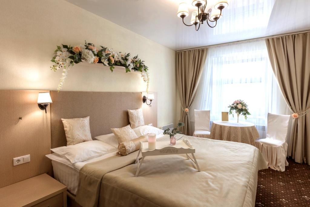 Кровать или кровати в номере Отель Столица Поморья