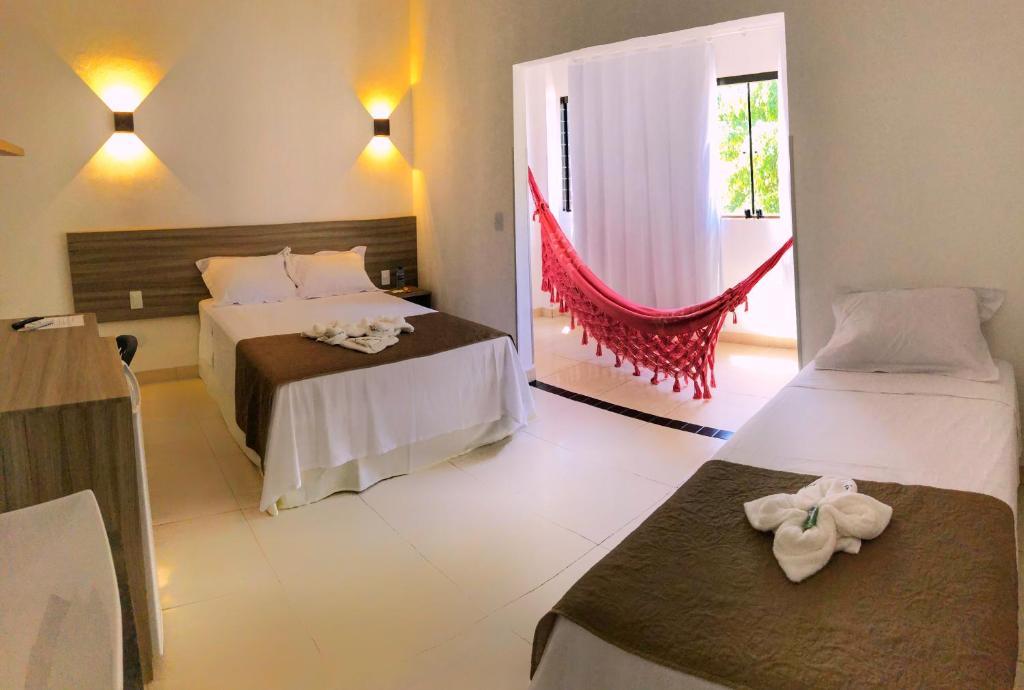 A bed or beds in a room at Pousada Paraíso Maragogi
