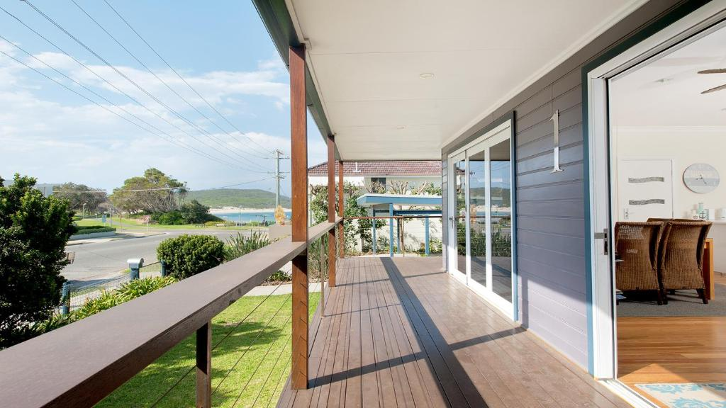 A balcony or terrace at No. 1 Fingal Bay Beach House - The Little Abode