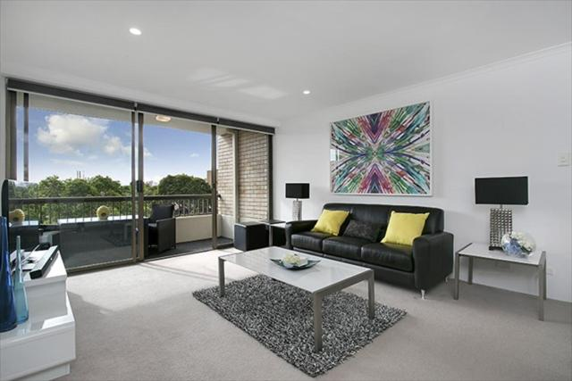 A seating area at Newly Renovated Immaculate One Bedroom Apartment in Cremorne - CREM4