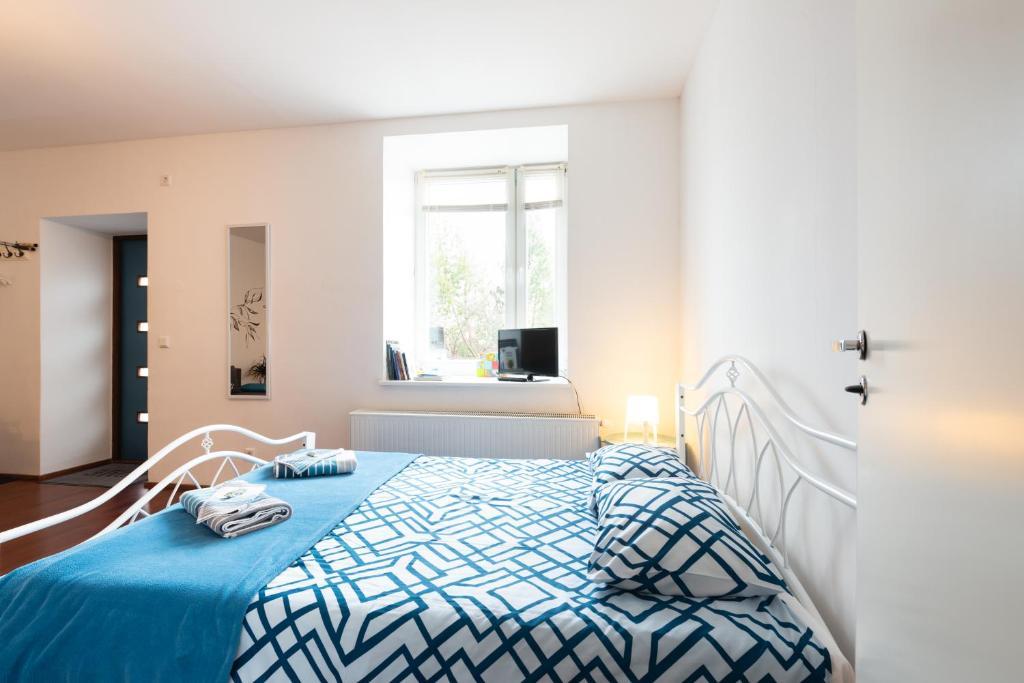 Voodi või voodid majutusasutuse Mereranna Apartments toas