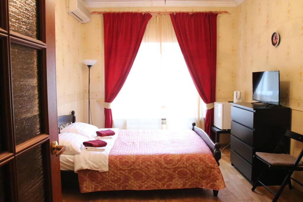 Кровать или кровати в номере Apartment Nevskaya Classica