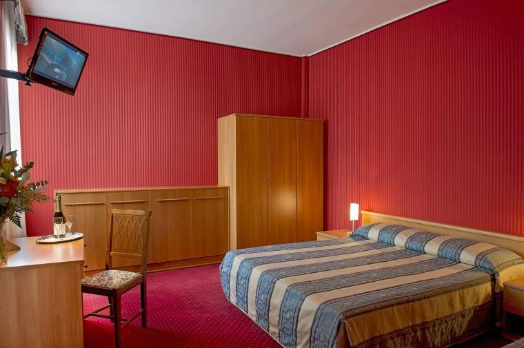 A bed or beds in a room at Hotel Nazionale