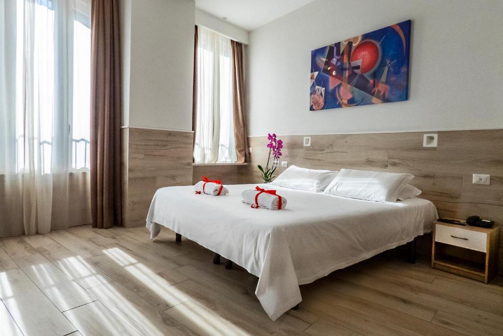 Un ou plusieurs lits dans un hébergement de l'établissement Eurohotel