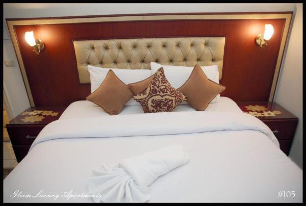 Cama o camas de una habitación en Gleem Luxury Apartments