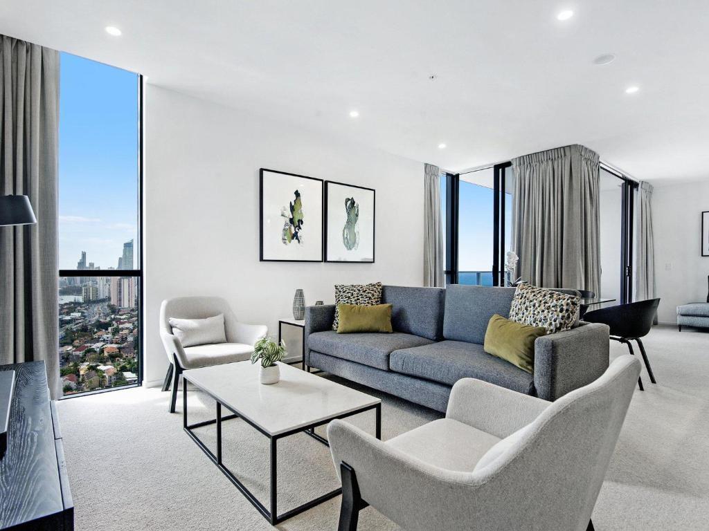 A seating area at Qube Broadbeach - Luxury 2 Bedroom Ocean View