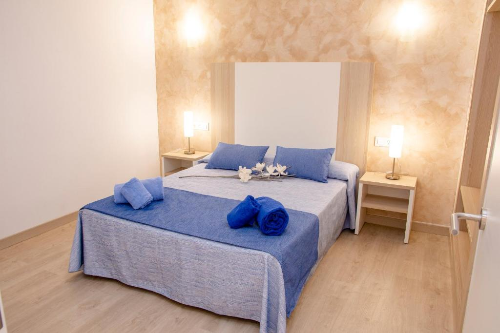 A bed or beds in a room at Apartamentos Maribel