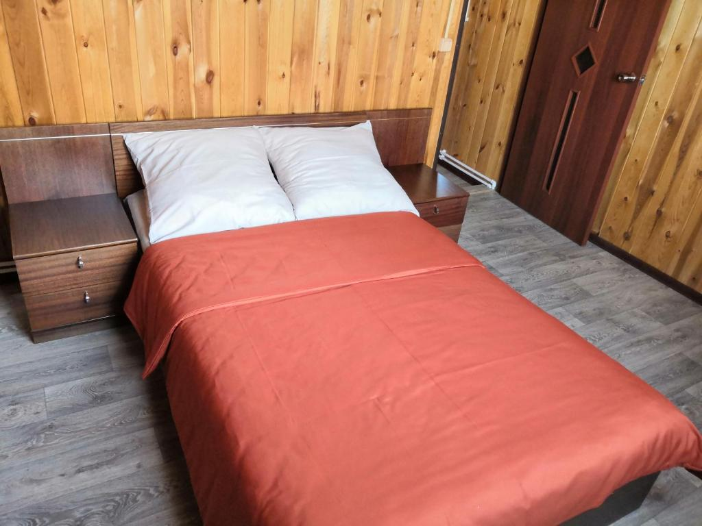 A bed or beds in a room at Vacation home in Baykalsk