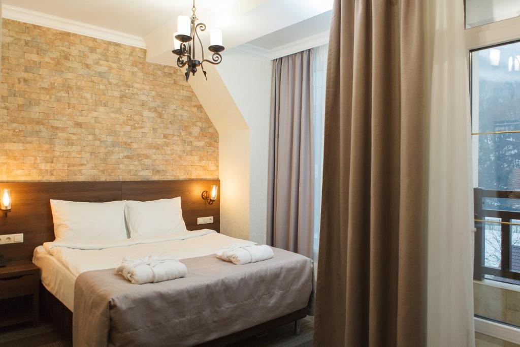 Кровать или кровати в номере Спа Отель Грейс Империал
