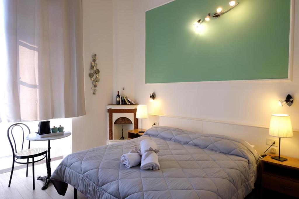 Cama o camas de una habitación en Residenza Le Rondini