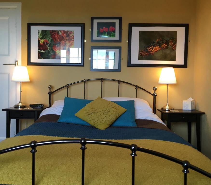 A bed or beds in a room at The Stanage B&B