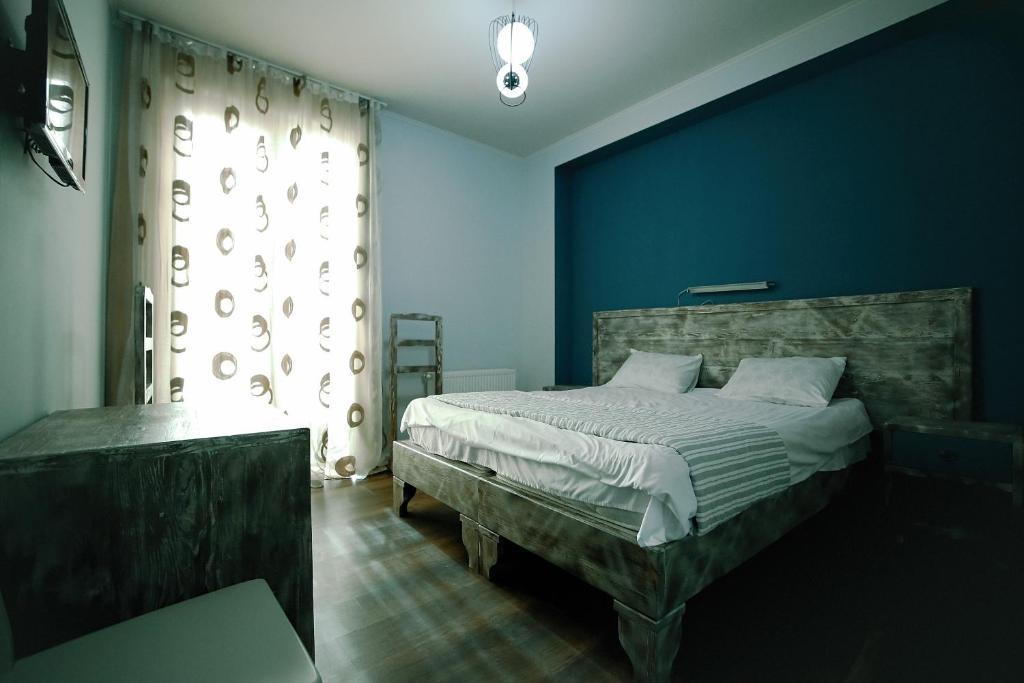 Кровать или кровати в номере Hotel Kutaisi Globus