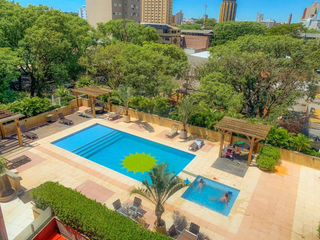 A view of the pool at Wyndham Golden Foz Suítes or nearby