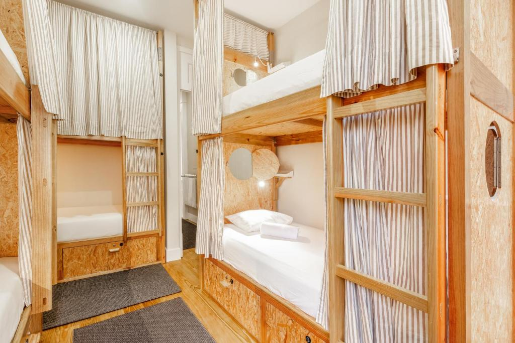 A bunk bed or bunk beds in a room at Fishtail Sea House