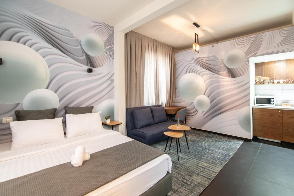A bed or beds in a room at Elliot Hotel Tel Aviv