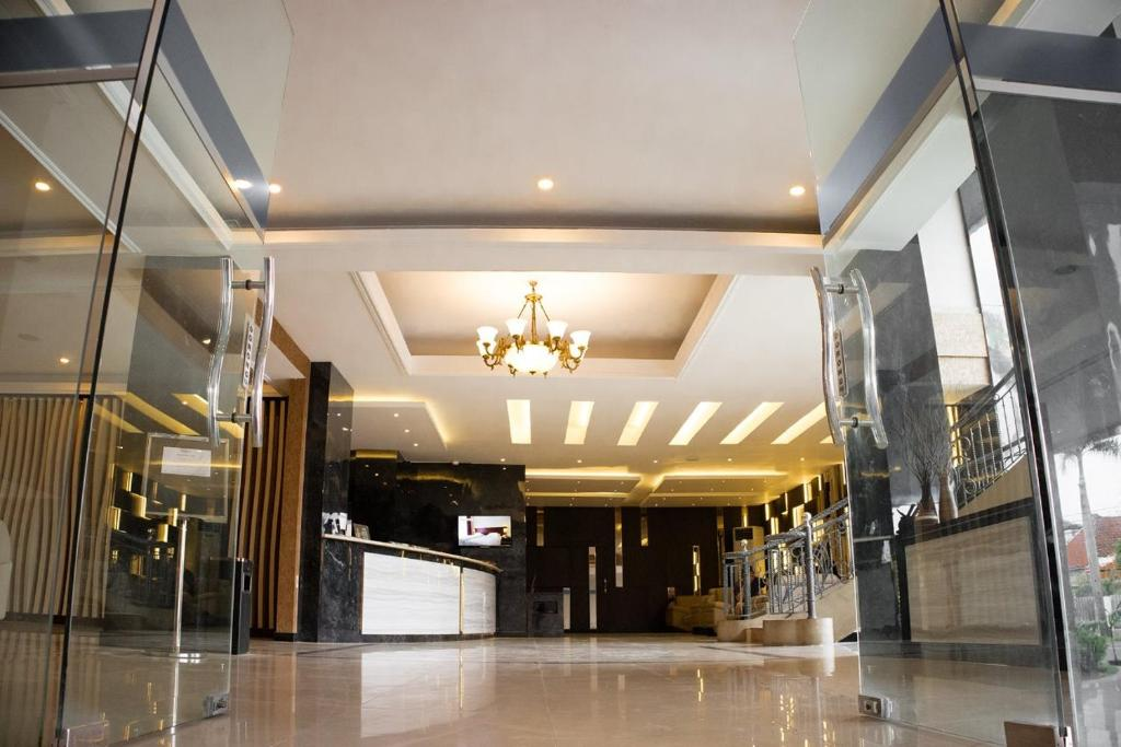 The lobby or reception area at Karlita Hotel Tegal
