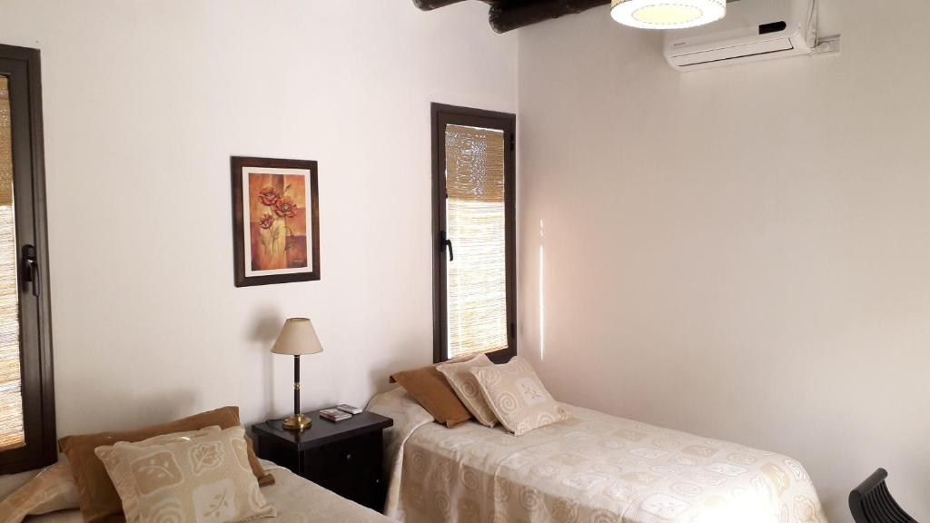 A bed or beds in a room at Viamonte Rest