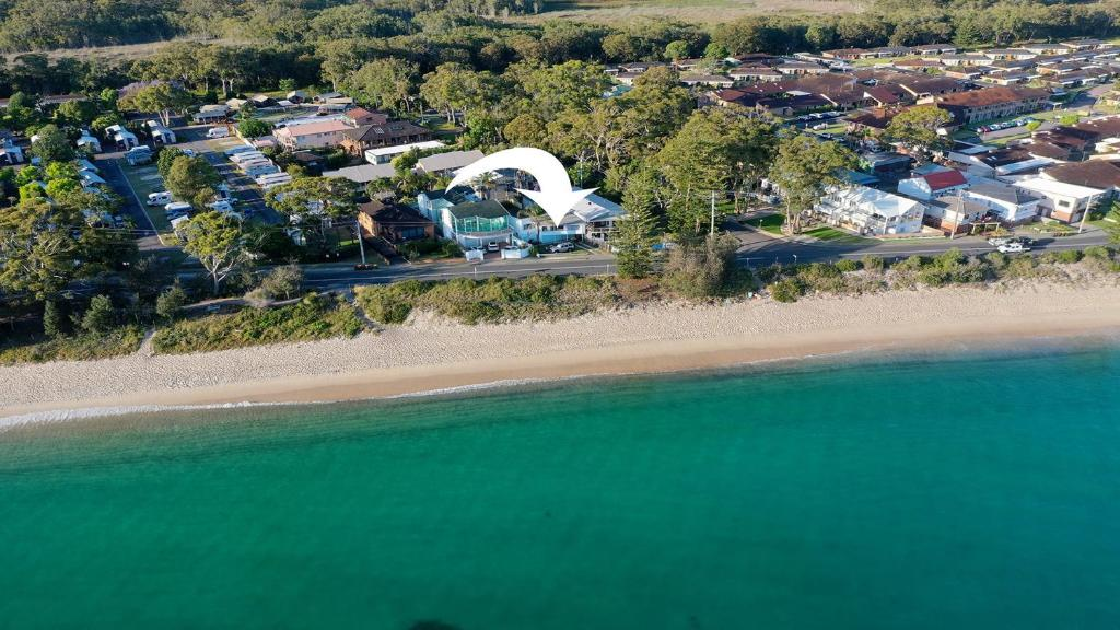 A bird's-eye view of Sand Beach House - breathtaking view, and amazing position directly opposite the beach!