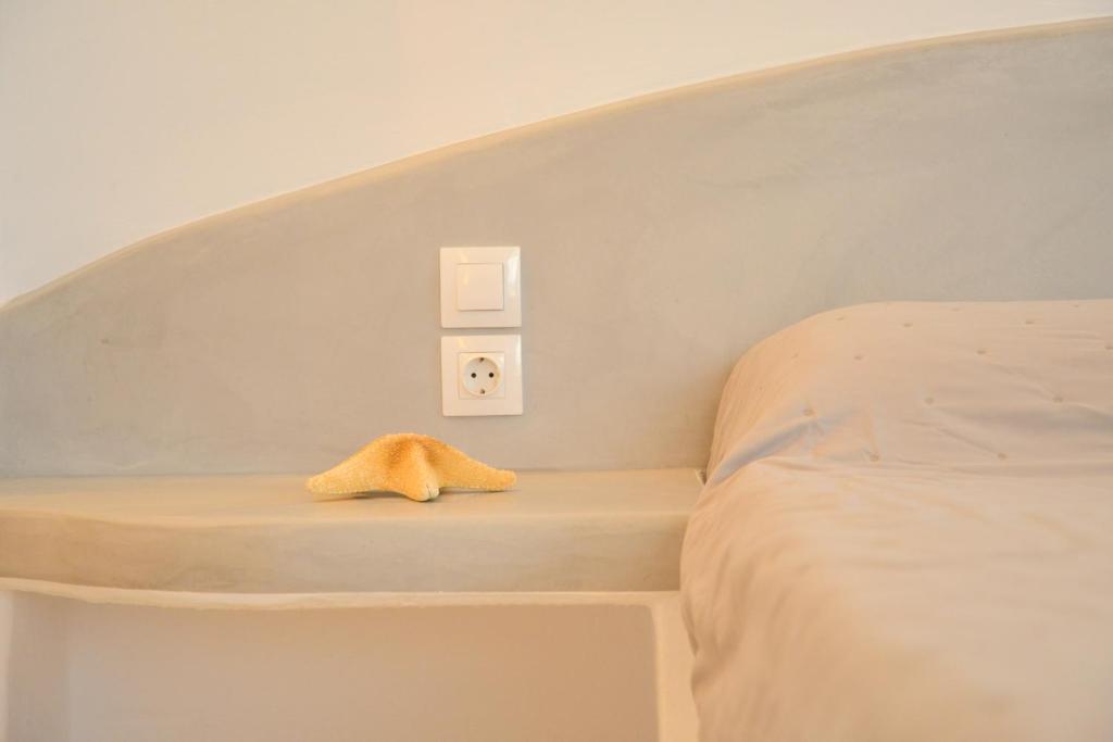 Ένα ή περισσότερα κρεβάτια σε δωμάτιο στο Ανάμνηση