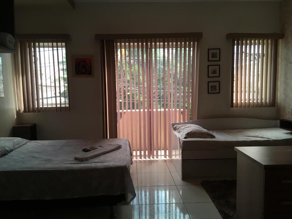A bed or beds in a room at Loft no Centro do Crato, ao lado da Praça da Sé