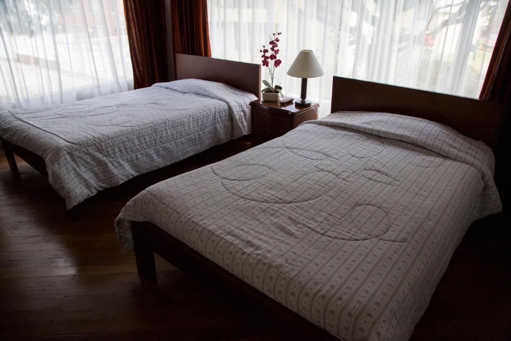 Cama o camas de una habitación en Hostal Bogotá Real