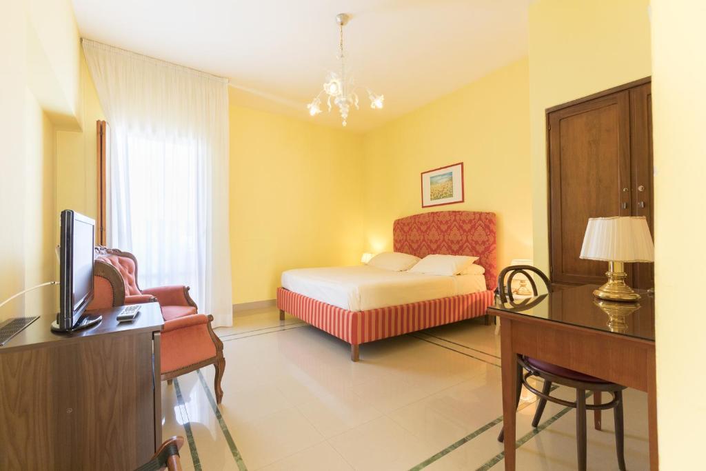 Ein Bett oder Betten in einem Zimmer der Unterkunft Hotel Palumbo Masseria Sant'Anna
