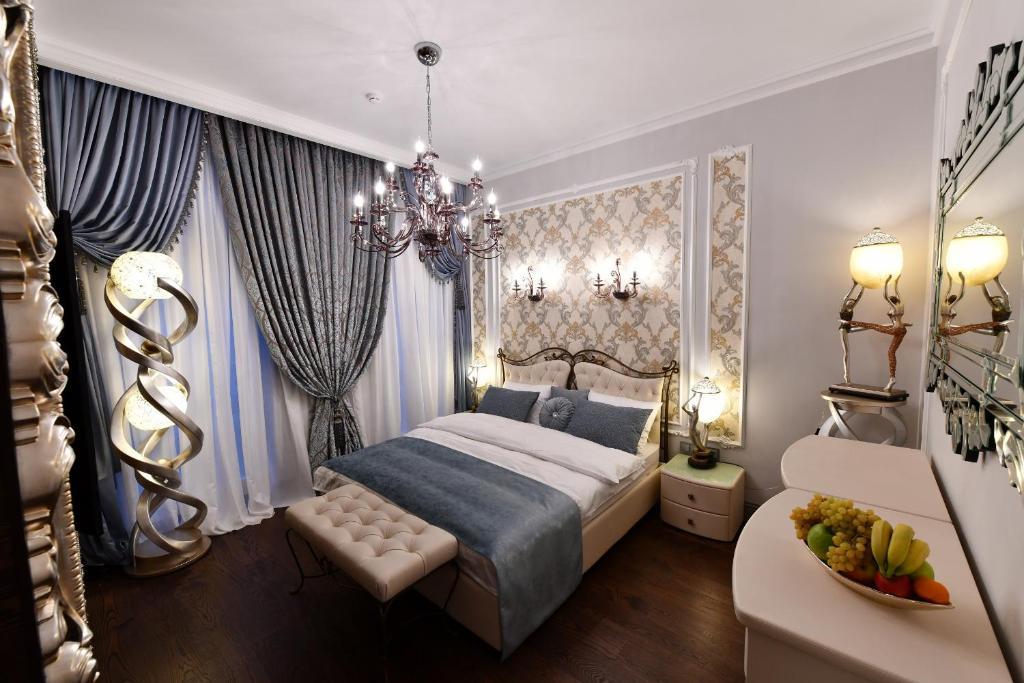 A bed or beds in a room at Hotel at the Rhythmic Gymnastics Center Irina Viner- Usmanova