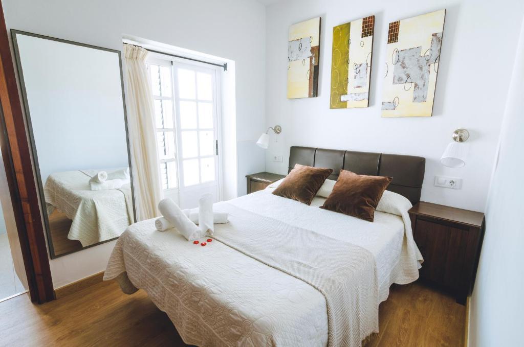 Cama o camas de una habitación en Hospedaje Villanueva
